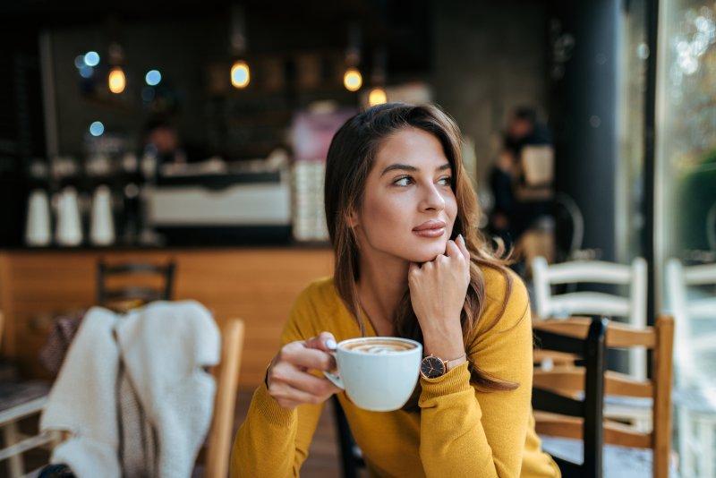 Woman drinking coffee in a coffee shop